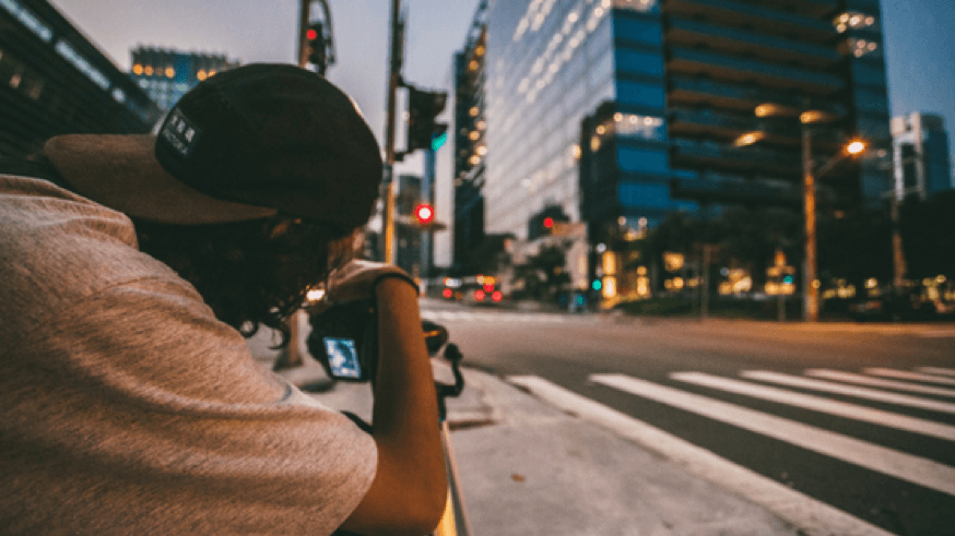 Taking a photo with a camera in a city